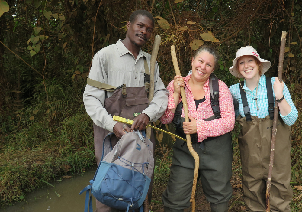 "Gray poses with Ugandan field assistant Kiberu Mutebi and Atkinson while sampling for the fish they call ""Bluelips,"" Ndyabusole, Uganda (2016). (Photo courtesy of Gray.)"