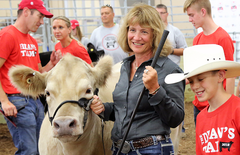 Dean Kress with steer and 4-H partner