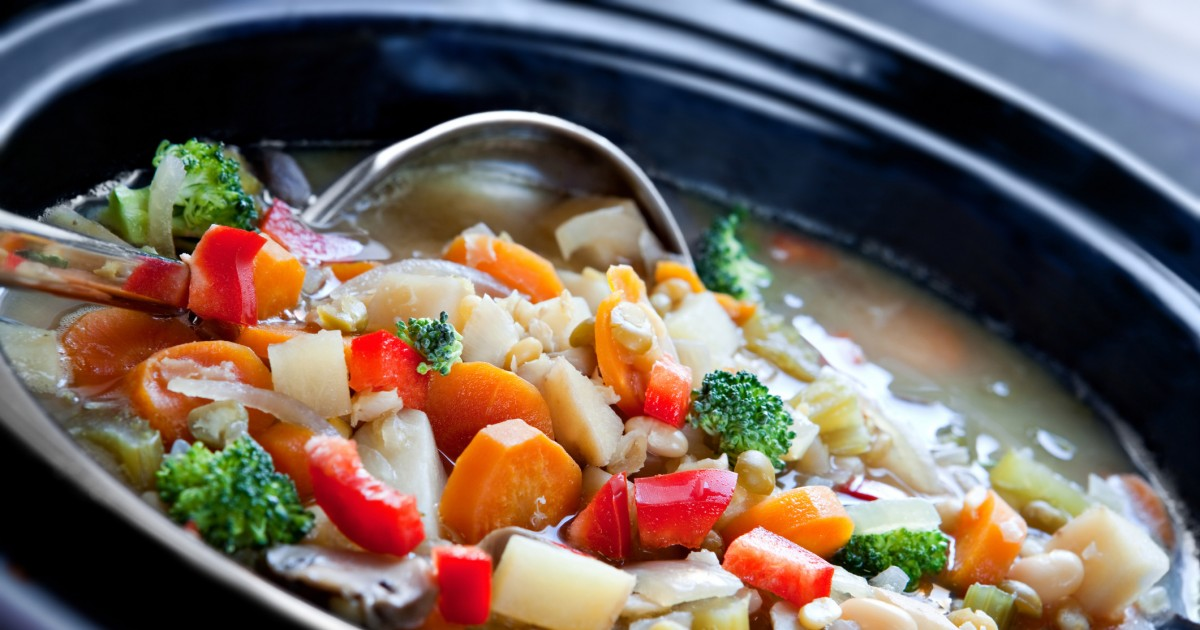 Slow cooker with vegetable soup