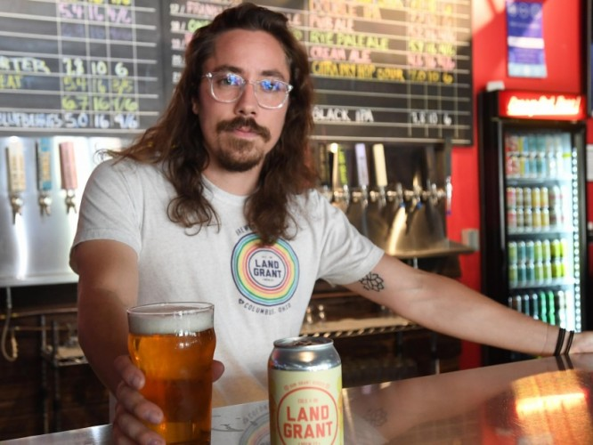 Sustainability manager Vinny Valentino behind the bar at Land-Grant Brewery.