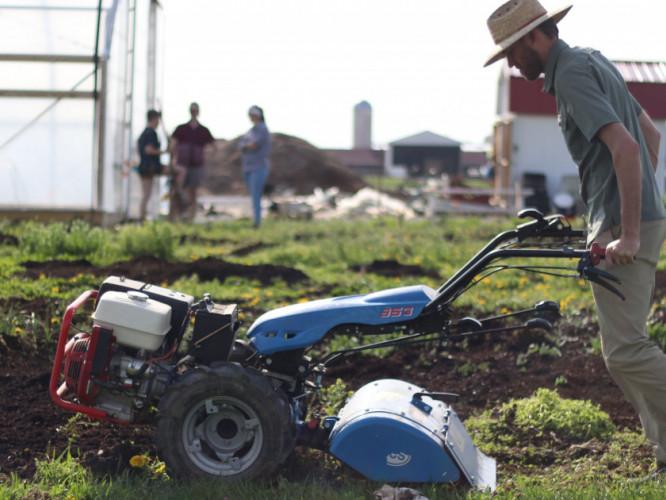 Student farm advisor Chris Ratcliff operates a BCS machine to break up the soil on Waterman Farm on April 18. Credit: Casey Cascaldo | Multimedia Editor