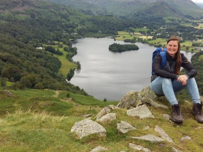 (Rachael Cline sits at the top of Loughrigg Fell, north of Liverpool where she interned for a semester.)