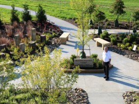 Donor Bill Lemmon stands in the new Health and Wellness Garden at Secrest Arboretum. (Photo by Ken Chamberlain)