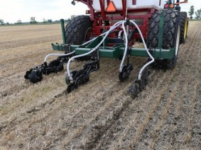 Manure being inserted into ground instead of spread on top of field to avoid manure run-off. Photo: Flickr