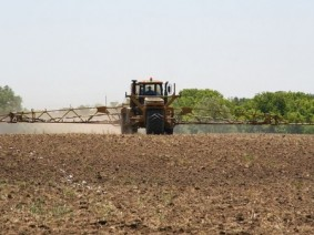A farmer spraying fertilizer on field. Photo: CFAES