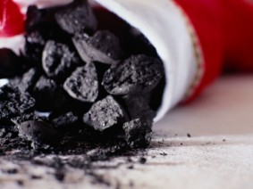 stock image of coal in stocking