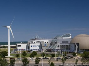Wind turbine and solar panels at the Great Lakes Science Center in Cleveland.