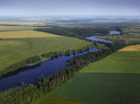 Aerial view of farm and river