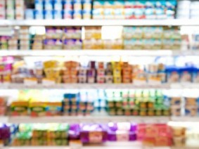 out-of-focus image of yogurt in dairy case