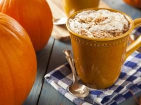 pumpkin latte next to pumpkins