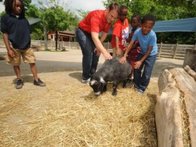 Program manager and students at petting zo