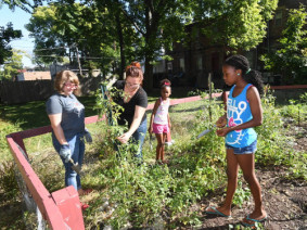 Working with families to create urban agriculture is just one of the many services that OSU Extension offers Ohioans. Photo: Ken Chamberlain.