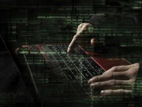 photo illustration of hacker at keyboard