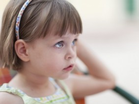 little girl looking pensive