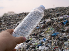 A plastic bottle and a landfill