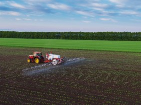Fertilizer spraying in farm field
