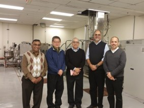 "Project investigation team meeting at the Advanced Technology Pilot Plant in CFAES' Parker Food Science and Technology Building. From right to left: Professor V.M. ""Bala"" Balasubramaniam, PBI Senior Vice President Edmund Ting, Professor Ahmed Yousef, Professor Rafael Jimenez-Flores, and Professor Christopher Simons. Photo: CFAES."