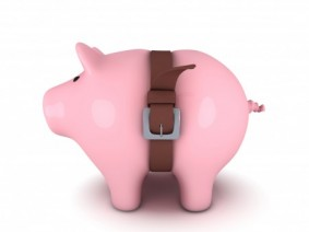 Photo of piggie bank with tight belt