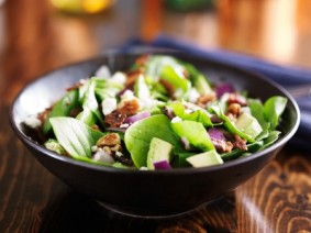 stock image of salad with nuts on top