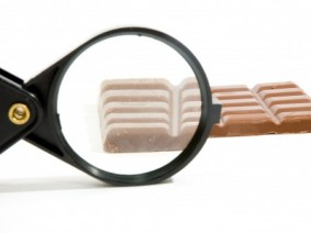 magnifying glass on piece of chocolate