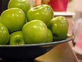 apples in bowl on counter