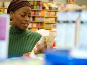 woman examining label at health food store
