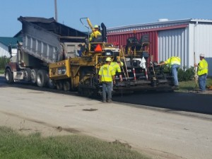 Friday Ave that runs down the middle of Farm Science Review is being repaved with ground tire rubber asphalt, a project funded in part by the Ohio EPA and the North Central Ohio Solid Waste District.