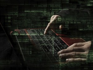 photo illustration of hacker at keyboard