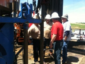 image of workers on shale development site