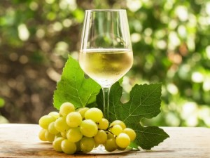 white grapes and a glass of white wine