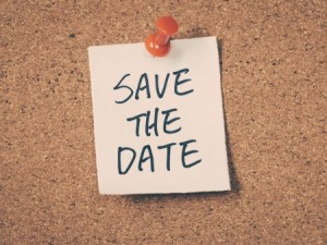 """A note talked to a cork board that says """"Save the Date"""""""