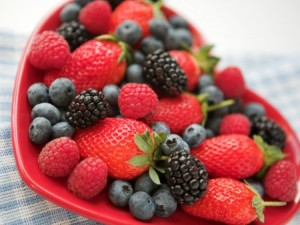 berries in a heart-shaped bowl