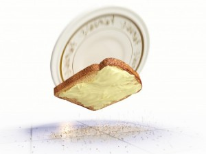 buttered bread falling with plate to the floor
