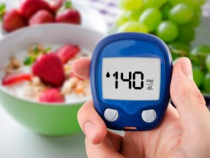 blood glucose meter with cereal and fruit in the background