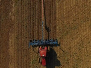Two agriculture experts from The Ohio State University have redesigned an attachment to a tractor that allows liquid manure to be applied to a growing crop. In the aerial photo, manure is being applied to a Darke County cornfield.