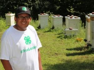 Jacob Shuman with beehives