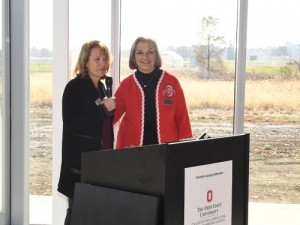 Dean Cathann A. Kress and Patricia Brundige behind a lectern