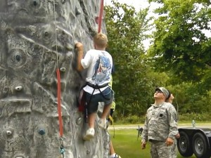 A camper practices his rock climbing skills at the Ohio 4-H Military Camp. Photo: Mitch Moser, CFAES.