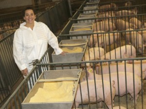 Monique Pairis-Garcia, Ohio State's new animal welfare specialist, at the university's swine facility. She happily admits she is partial to pigs. (photo: CFAES Department of Animal Sciences)