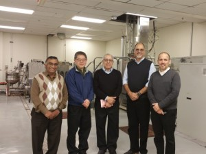 """Project investigation team meeting at the Advanced Technology Pilot Plant in CFAES' Parker Food Science and Technology Building. From right to left: Professor V.M. """"Bala"""" Balasubramaniam, PBI Senior Vice President Edmund Ting, Professor Ahmed Yousef, Professor Rafael Jimenez-Flores, and Professor Christopher Simons. Photo: CFAES."""